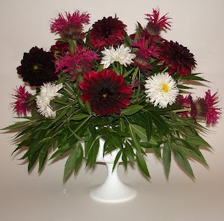 Black Dahlia shasta daisy and bee balm floral arrangement
