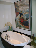 Art and jet tub in funky bathroom
