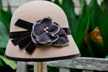 Camel Felt cloche with brown flower and ribbon