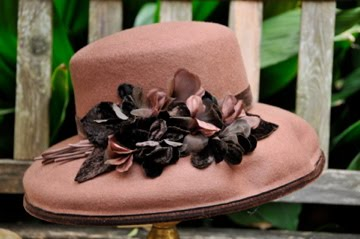 Brown felt hat with millinery flowers and velvet trim