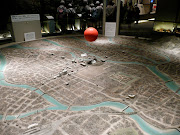 There are a few dioramas depicting the city before and after the bomb, . (bomb ball)