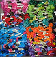 many skeins of embroidery floss in several different colors