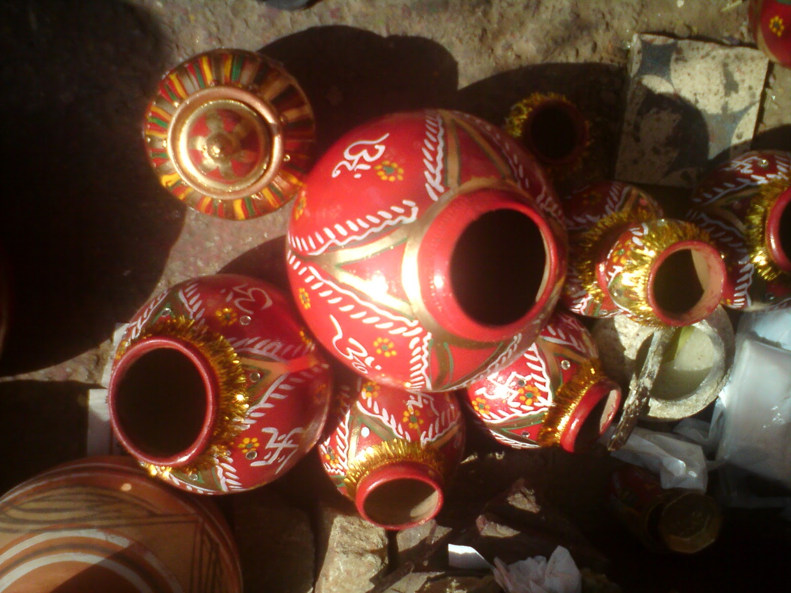 The finished earthen pots being dried in the sun