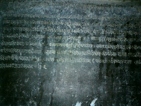 An ancient slab of black stone with some inscriptions in 