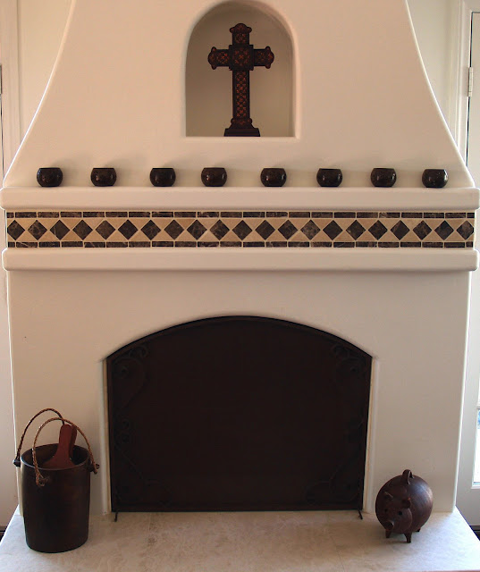 Dusty wheeler stone tile spanish style home in tierrasanta for Spanish style fireplace