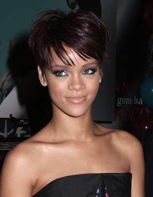 At the moment Rihanna may have big curly red hair or short bobbed red hair