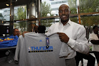Oklahoma City Thunder Forward Damien Wilkins Holds Up Official Team Merchandise
