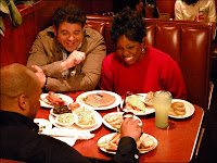 Man v. Food - Adam Richman sitting at a booth with Gladys Knight at Gladys Knight and Ron Winans Chicken & Waffles in Atlanta, GA