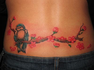 lower back tattoo for women. Lower back is still very much