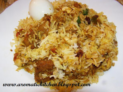 Chicken Biriyani,Rice cooked with chicken , spices and herbs
