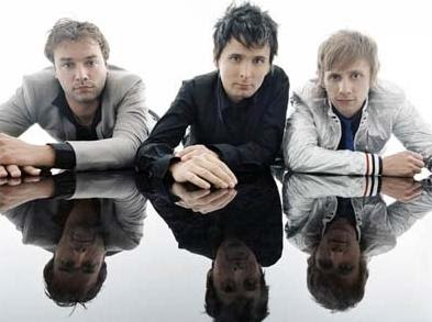 Hit Rock Band Muse promo photo on a mirrored surface