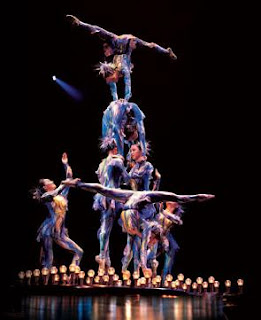 Cirque performers in human pyramid