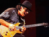 Carlos Santana on stage playing his guitar