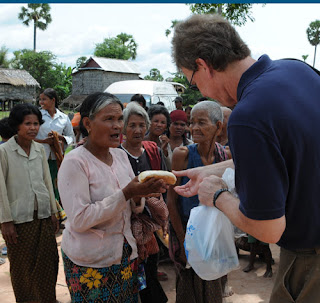 Dr. Don Rahtz, my professor, handing out bread at the Shinta Mani Village. He wanted to be certain the two oldest ladies in the village were fed.