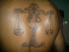 Colorful Tribal Libra Tattoo Painted On Back