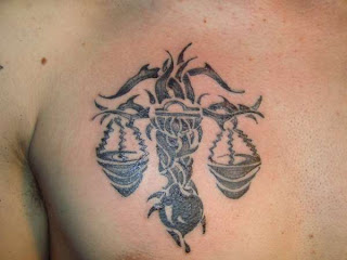 Black And White Tribal Libra Tattoos Painted On Chest