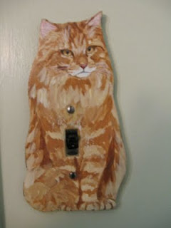 another cat shaped light switch plate by Helen