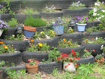 flowers in tire retaining wall