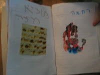 two pages of preschool haggadah, with hand-print and square of matzah paper.