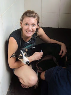 Volunteer Jo in the dog kennels