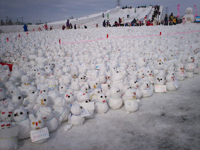 field of tiny snowmen