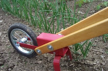 Gardening is a whole lot easier with the Planet Whizbang wheel hoe!