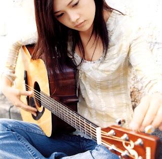 Yui -Discografia  Yuihappyline