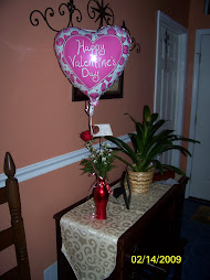 Griffin's Balloon and rose