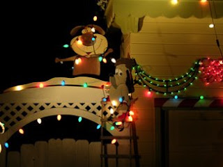 Dogs stringing Christmas lights