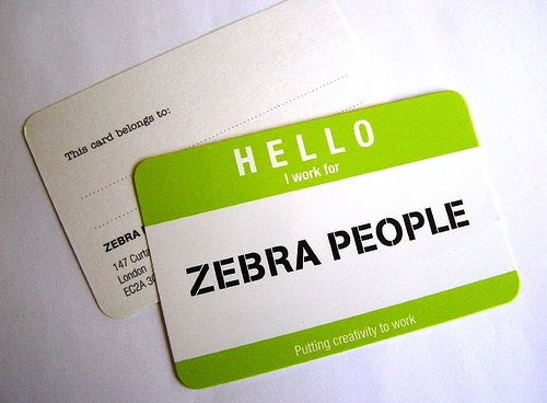 A business card designed to look like a hello my name is sticker
