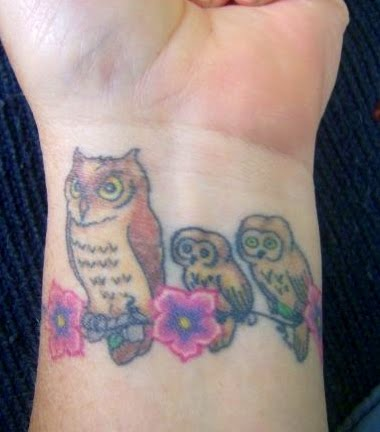 Owls Sitting on Flower Vine Tattoo