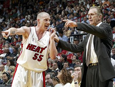 Pat Riley helping one of his players