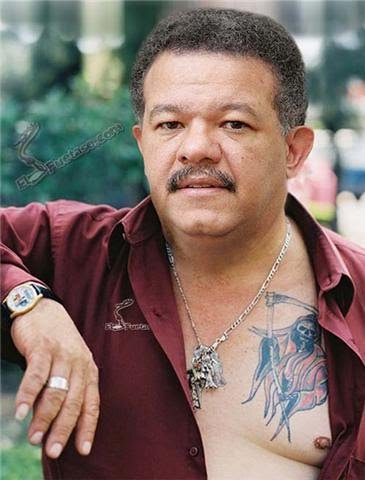 tatuajes de alacranes. leonel fernandez tatuaje. jael_xp Dominicanos por el mundo: LEONEL FERNANDEZ