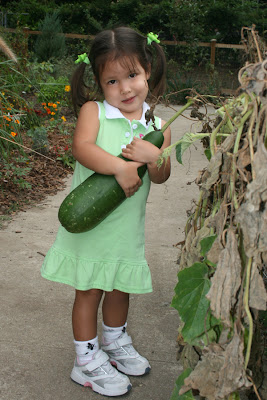 Gabi with a giant squash at Scott Park