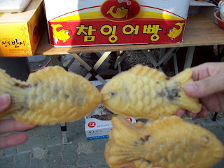 Photo of three fish pastries, with two kissing each other lip to lip