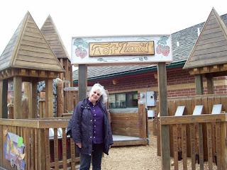 Marsha at the gate to Tot Land at Dragon Hollow