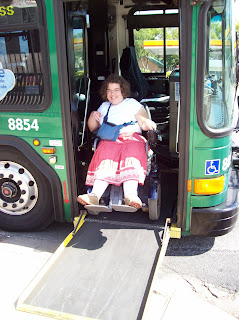 Sarah exiting bus in her power chair