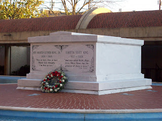The white double tomb of Dr. and Mrs. King in the blue reflecting pool