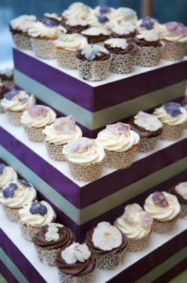 A purple and turquoise tiered cupcake display.
