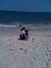 Sweet baby James looking at ocean with mommy