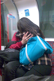 Ugly people snogging on the Central Line