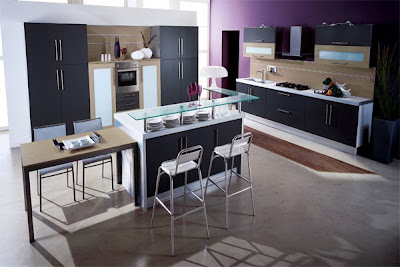 Small-modern-kitchen-with-beige-stone-floor-black-door-cabinets-and-drawers-with-white-chairs