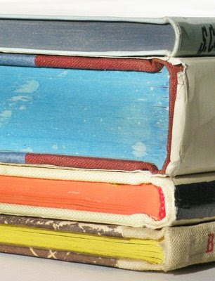 photograph of colorful ink-edged pages of vintage book volumes