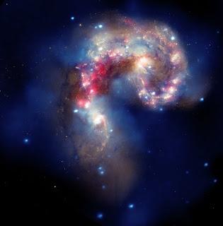 Imagen compuesta de las galaxias Antennae, a partir de datos de Chandra, Hubble y Spitzer