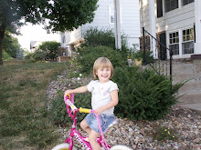 Cora LOVES to ride her bike! Everytime we are outside, she's on her bike!