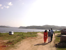 "Guruji...Walking towards the river in the village ""AWERAHALLI"" A proposed site of ""Yogic Divine...."
