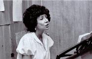 Sara singing and playing the piano at Park Maitland School