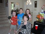 Sara with grandchildren Lindsay, Evan and Blake