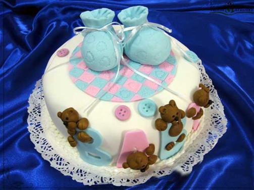 Torta de Baby Shower decorada con ositos, botines y botones modelados ...