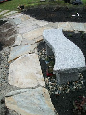 Flagstone path and granite bench